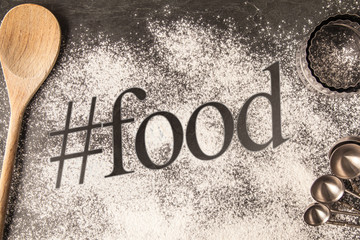 Handwritten word drawn in the flour - hashtag food