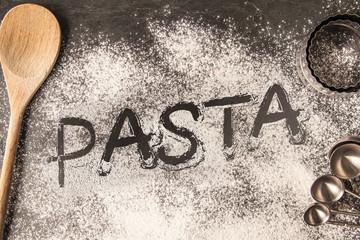 Handwritten word drawn in the flour - Pasta