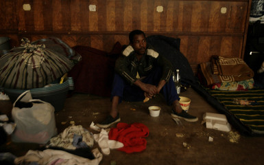 A man displaced during anti-foreigner violence seeks refuge in the Germiston town hall near Johannesburg
