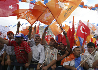 Supporters waving party flags cheer for Turkey's Prime Minister Erdogan during a rally of his ruling AK Party in Ankara
