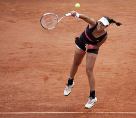 Serbia's Ana Ivanovic serves to Belgium's Justine Henin during the women's finals of the French Open tennis tournament at Roland Garros in Paris