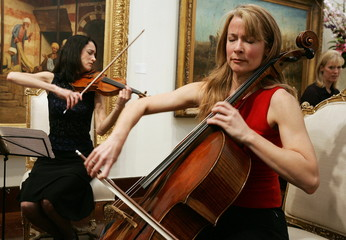 """Violinist Adela Pena (L) of the world famous Eroica Trio performs on the """"Lady Tennant"""" violin built.."""