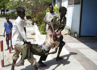 A civilian wounded during a blast is carried into Madina hospital in Mogadishu