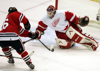 Detroit Red Wings goalie stops a shot by Chicago Blackhawks Bartovic during their NHL game in Detroit