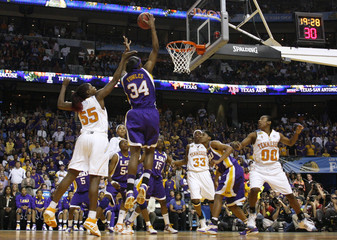 LSU center Sylvia Fowles grabs a rebound as Tennessee players look on in the first half of their NCAA Women's Final Four semi-final basketball game in Tampa