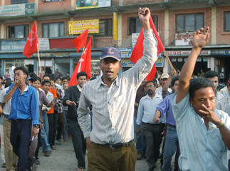 PROTESTERS SHOUT SLOGANS DURING A RALLY IN KATHMANDU.