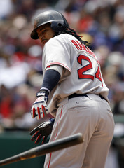 Boston Red Sox's Manny Ramirez of the Dominican Republic heads to first base after drawing a walking off of Texas Rangers starting pitcher Robinson Tejeda in Arlington,