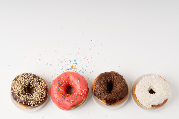 donuts on a plate on a white background