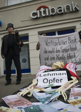 Small investors who lost money due to the collapse of the Lehman Brothers investment bank protest in front of Citibank branch in Berlin