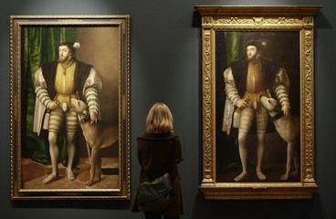 "A woman looks at paintings titled ""Carlos V con un perro"" by Austrian artist Jacob Seisenegger in Madrid"
