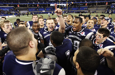 Connecticut Huskies' Lorenzen celebrates with his teammates after they defeated Buffalo Bulls in Toronto
