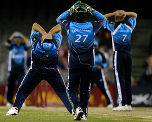 World XI team members react after Kallis just missed running out Australia's Ponting during third one-day game in Super Series at Melbourne's Telstra Dome