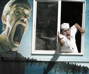 A man dressed up as a zombie reaches out of an ice cream truck during the 40th annual Comic Con Convention in San Diego