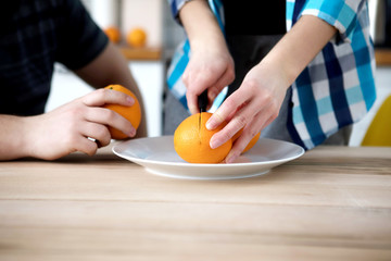 Cutting oranges, fruits