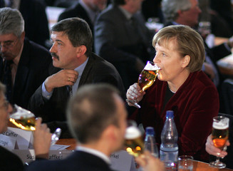 German Chancellor Merkel, chairwoman of the Christian Democratic Union (CDU), drinks a beer during a CDU Ash Wednesday political gathering in the northern German town of Demmin