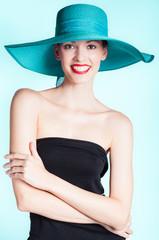 Beautiful happy woman posing in a hat.