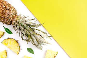 summer mockup with pineapple on yellow and white background top view
