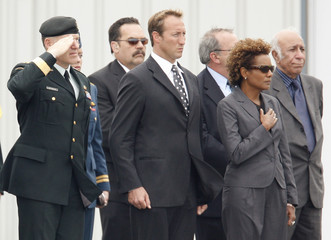 General Natynczyk salutes beside Minister of National Defence MacKay and Governor General of Canada Jean at CFB Trenton