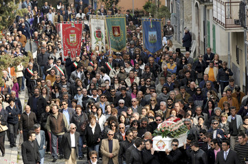 Coffin of earthquake victim Carmelina Iovine is carried to her funeral in the Italian town of Raiano