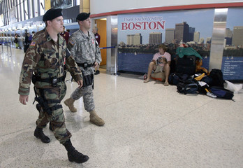 Massachusetts National Guardsmen walk through terminal at Logan International Airport in Boston