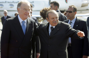 Algerian President Abdelazziz Bouteflika greets his Portuguese counterpart Jorge Fernando Sampaio in Algiers