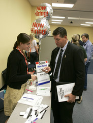 Sears employee recruiter Kali Bale speaks with Terry Crawford, a U.S. Army veteran, at a veterans job fair at Workforce Alliance in West Palm Beach