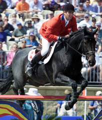 BEAT MAENDLI OF SWITZERLAND RIDING 'POZITANO' CLEARS AN OBSTACLE DURING THE INDIVIDUAL JUMPING ...