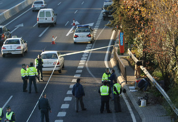 Spanish police search for clues at the site of a small blast just outside Madrid