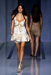 Models present creation by designer Antonio Pernas during the Pasarela Cibeles fashion show in Madrid.