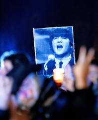 John Lennon fans hold a candlelight vigil on the 25th anniverary of Lennon's death at Strawberry Fields in Central Park in New York City