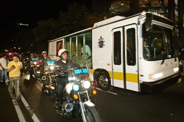 Mexican police ride beside the popemobile that the late Pope John Paul II had used during his trips ...