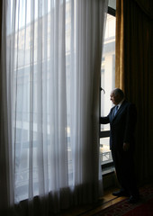 Chile's President Lagos looks through a windows during an interview in Santiago