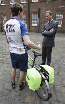 """Britain's Prince William talks to a member of the """"Cycle of Life"""" team at Clarence House in London"""