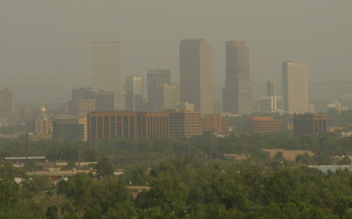 WILDFIRE SMOKE SHROUDS DENVER SKYLINE.