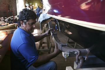 Uruguayan blacksmith Longo works on a carriage in a workshop in Montevideo