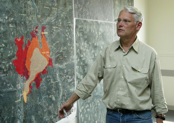 BRITISH COLUMBIA PREMIER CAMPBELL LOOKS OVER THERMAL MAPS OF WILDFIRES.