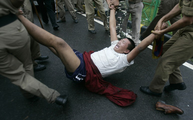A Tibetan exile is carried away by Indian police in New Delhi