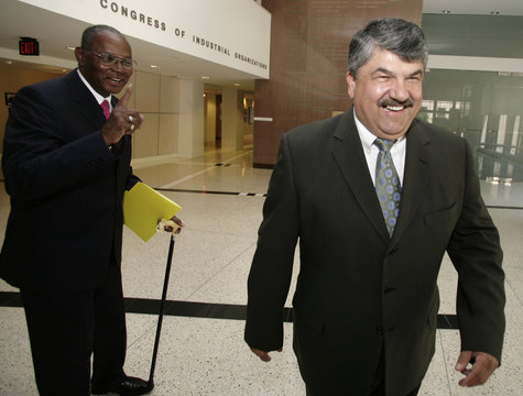 Bill Lucy of the AFL talks to Secretary-Treasurer of the AFL-CIO Richard Trumka in the lobby of their office in Washington