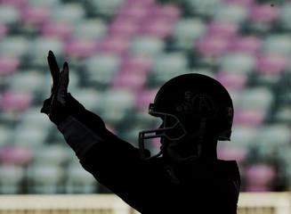 Toronto Argonauts quarterback Damon Allen is silhouetted during Grey Cup practice.
