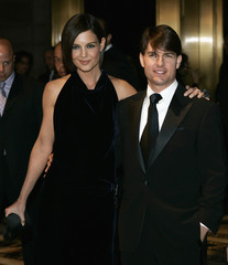 Tom Cruise poses with his wife Katie Holmes upon arriving at the Museum of the Moving Image Salute in New York
