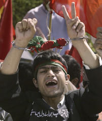 An activist from a Pakistani opposition party shouts slogans during a rally against the suspension of Chief Justice Iftikhar Chaudhry in front of Supreme Court in Islamabad