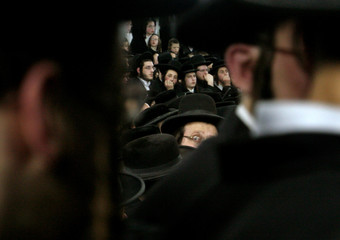 Ultra-orthodox Jews listen to their rabbi during a special speech for the Jewish 'Tu B'Shvat' ...