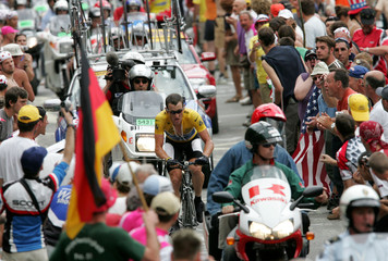 Armstrong of U.S. wins the 16th stage of the Tour de France, a mountain time trial to L'Alpe d'Huez.