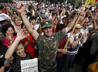 Local residents of South Ossetia attend a rally in Tskhinvali