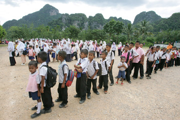 Thai students queue to go home after finishing class in the largely Muslim province of Yala.