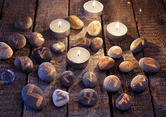 Mystic still life with stone runes and candles. Divination rite