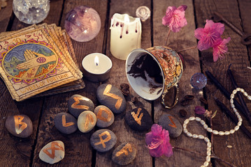 Divination rite with coffee grounds, tarot cards and stone runes reading