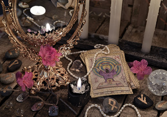 Close up with the tarot cards, mirror and black candle. Divination rite
