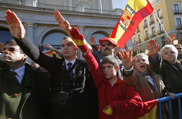 Supporters of Spain's late dictator Francisco Franco raise their arms in a fascist salute during a gathering in Madrid