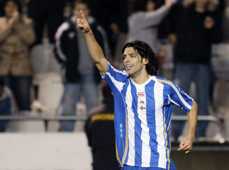 Deportivo Coruna's Lafita celebrates his goal against Malaga during their Spanish First Division soccer match in Coruna